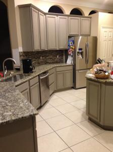 Kitchen after custom finish, backsplash, appliances and countertops.  Look closely, the work wasn't finished here yet--hardware, drywall, etc.